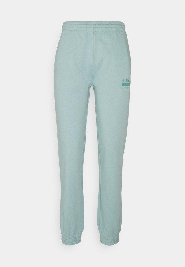 NAJOGGER - Teplákové kalhoty - light/pastel green