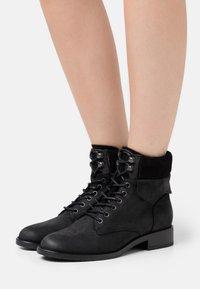 Anna Field - LEATHER - Šněrovací kotníkové boty - black - 0