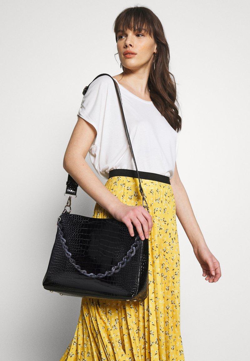 HVISK - AMBLE CROCO - Handbag - black