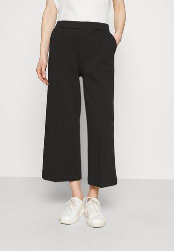MARISI - Trousers - black