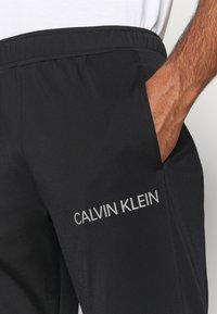 Calvin Klein Performance - TRACKSUIT - Tracksuit - black/bright white - 9