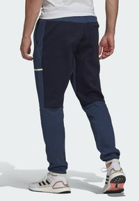 adidas Performance - Z.N.E. SPORTSWEAR PRIMEGREEN PANTS - Pantalon de survêtement - blue - 1