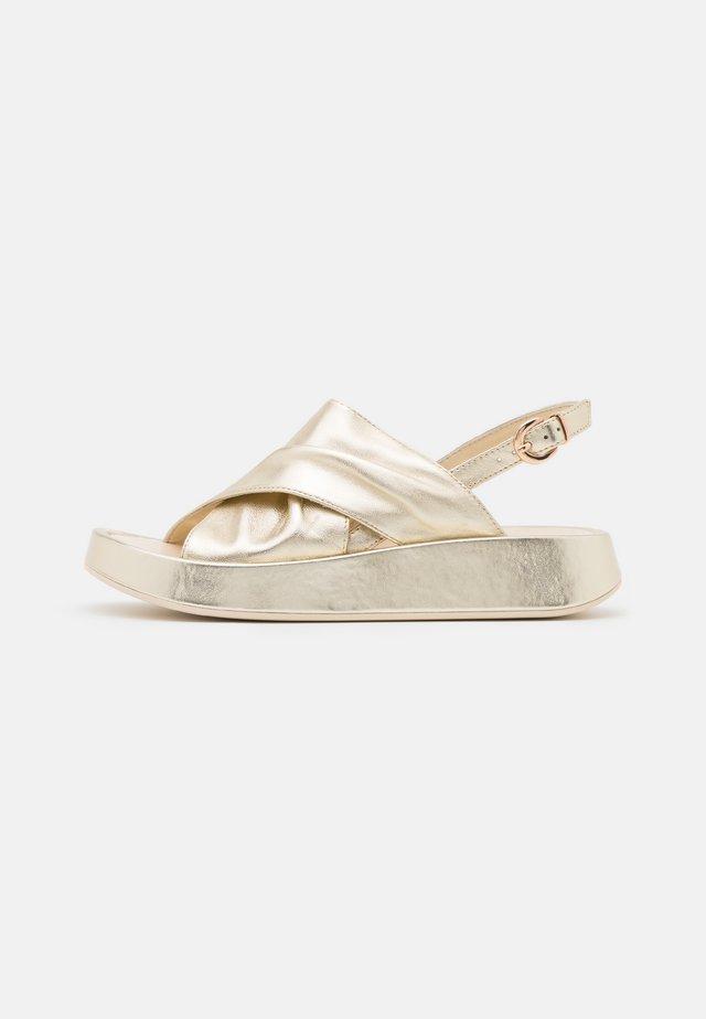 TOPAZ - Platform sandals - oro