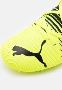 Puma - FUTURE Z 3.1 MG JR UNISEX - Moulded stud football boots - yellow alert/black/white - 5