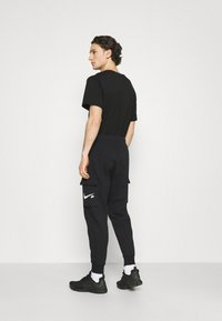 Nike Sportswear - COURT PANT - Tracksuit bottoms - black