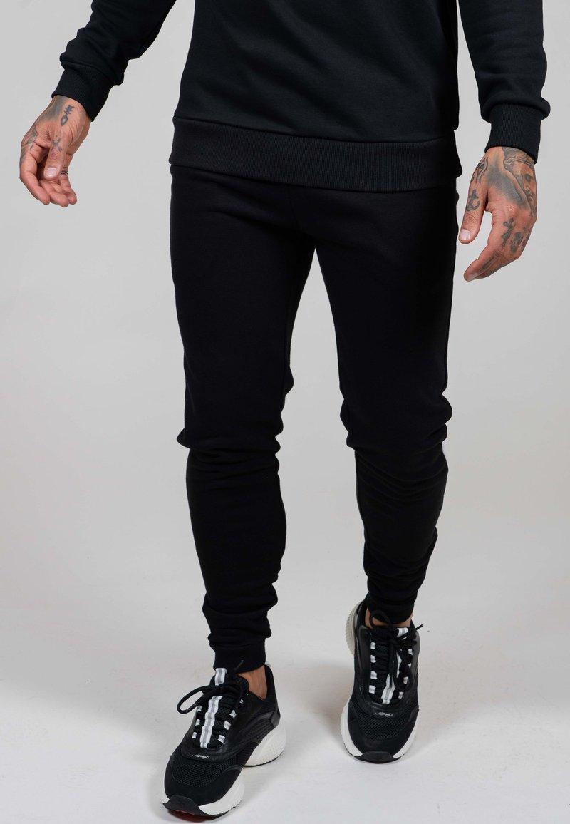 Ed Hardy - ED PANEL JOGGER - Tracksuit bottoms - black