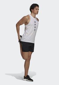 adidas Performance - RUN LOGO TANK M - Sports shirt - white - 1