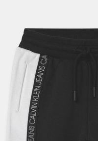 Calvin Klein Jeans - COLOUR BLOCK  - Pantalones deportivos - black - 2