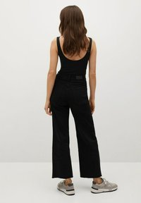 Mango - CATHERIN - Flared Jeans - black denim - 2