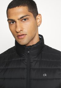 Calvin Klein - LIGHT WEIGHT SIDE LOGO VEST - Waistcoat - black - 3