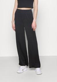 NA-KD - MATIAMU BY SOFIA X STRUCTURED WIDE LEG PANTS - Trousers - black - 0