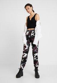 Urban Classics - LADIES HIGH WAIST CAMO CARGO PANTS - Trousers - wine - 1