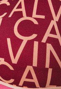 Calvin Klein Performance - LOW SUPPORT BRA - Sport-bh met light support - red - 2