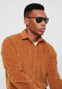 Ray-Ban - Solbriller - brown/green - 1