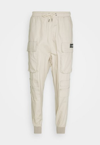 NEW PANTS - Cargo trousers - beige