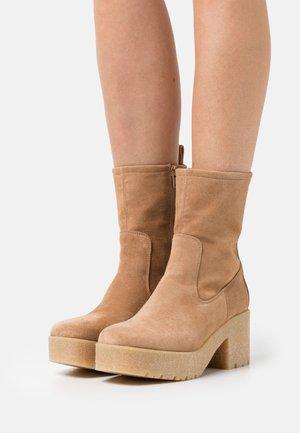 KRIPTO - Platform ankle boots - sand