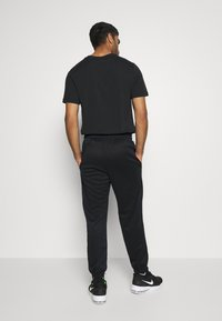 Nike Performance - SPOTLIGHT PANT - Tracksuit bottoms - black - 2