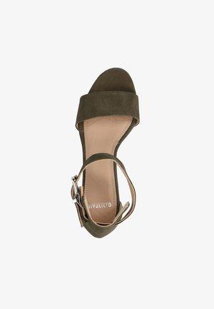 High heeled sandals - grün