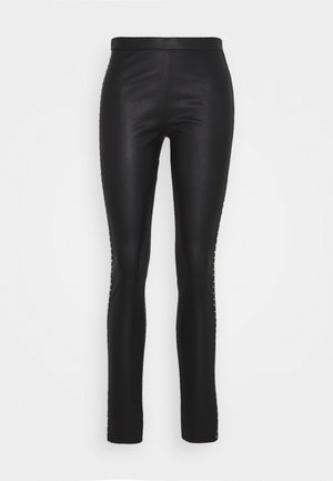 STUDS - Leather trousers - black/gold