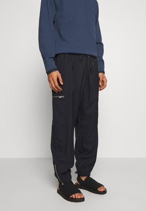 TRACK PANT - Tracksuit bottoms - midnight