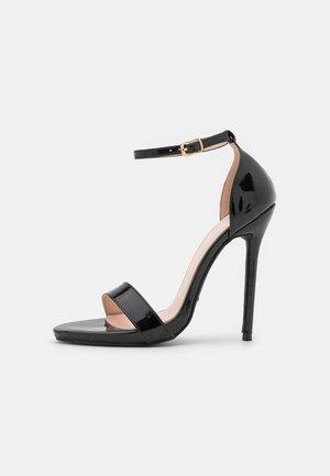 NILA - Sandaalit nilkkaremmillä - black