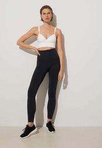 OYSHO - Medium support sports bra - white - 2