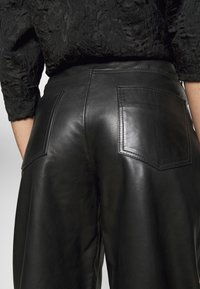 Lovechild - ASTON - Leather trousers - black - 3
