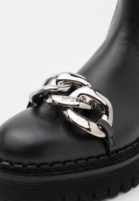 N°21 - BOOTS - Platform ankle boots - black - 6