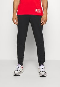 Champion - LEGACY  - Tracksuit bottoms - black - 0