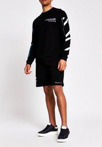 River Island - Long sleeved top - black - 1