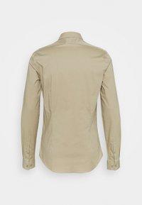 Calvin Klein Tailored - LOGO STRETCH EXTRA SLIM - Formal shirt - beige - 1