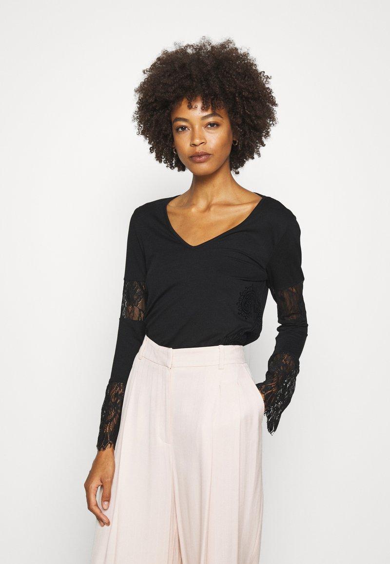 Desigual - AMELIA - Long sleeved top - black