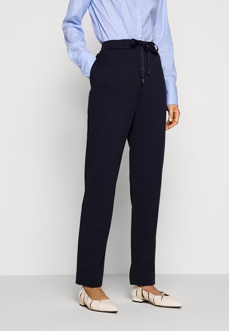 HUGO - HONESI - Trousers - open blue