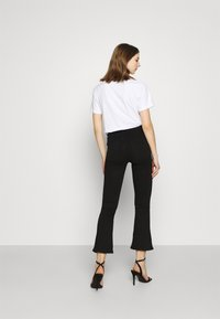 ONLY - ONLRAIN SWEET - Flared Jeans - black - 2