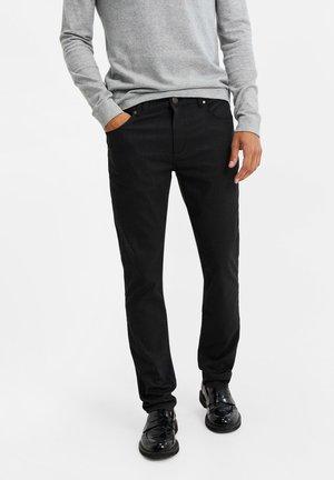 SLIM FIT - Trousers - black
