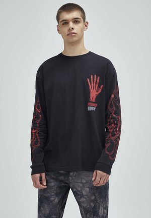 Långärmad tröja - mottled black