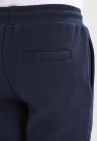 Ellesse - OVEST - Tracksuit bottoms - dress blues - 4