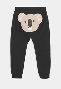 Lindex - TROUSERS KOALA BEAR AT BACK UNISEX - Trousers - off black - 1