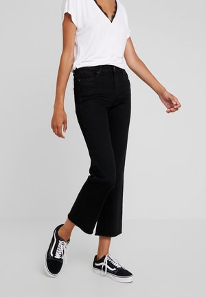 VMSHEILA KICK - Flared Jeans - black