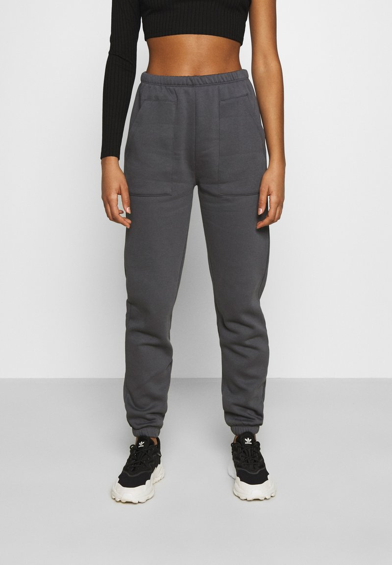 Nly by Nelly - COZY POCKET PANTS - Tracksuit bottoms - off-black