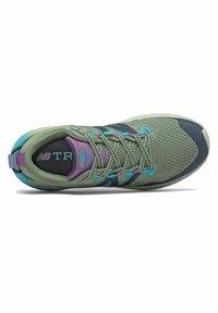 New Balance - Trail running shoes - green - 1