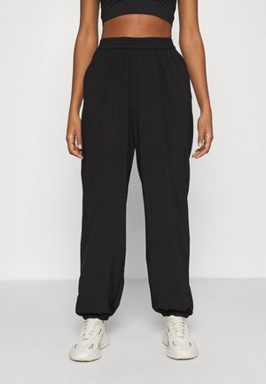 NA-KD X ZALANDO EXCLUSIVE - SPORTY FABRIC PANTS - Tracksuit bottoms - black