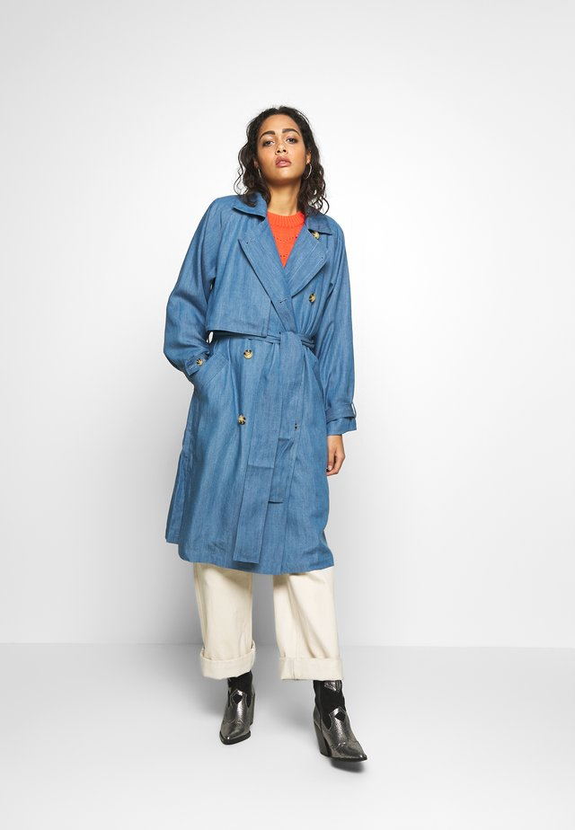 Trenchcoats - light blue denim