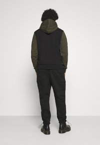 Calvin Klein Jeans - TECHNICAL - Cargo trousers - black - 2