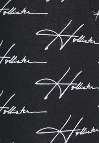Hollister Co. - SINGLE PATTERN CONVO  - Pants - black - 4