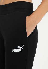 Puma - ESS CAPRI PANTS  - 3/4 sportsbukser - cotton black - 3