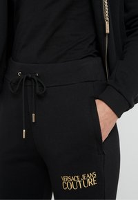 Versace Jeans Couture - Tracksuit bottoms - nero - 4