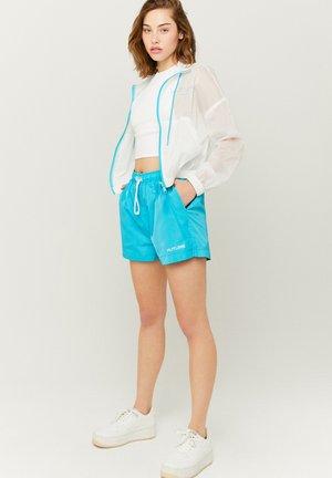 MIT AUFDRUCK - Shorts - blue