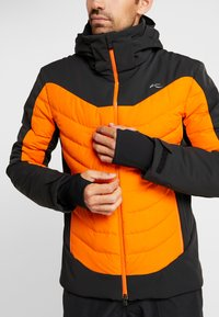 Kjus - MEN SIGHT LINE JACKET - Ski jacket - black/orange - 6
