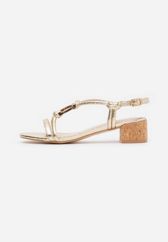 JANIITA - Sandals - gold